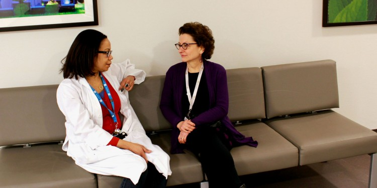 In the Emergency Department's Psychiatry lounge, Dr. Judy Glass (right) chats with Emergency Psychiatry Nurse Johane Celestin.