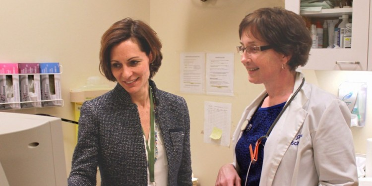 Dr. Stephanie Klam (left) and Nurse Clinician Linda Joyce review a patient's ultrasound results.