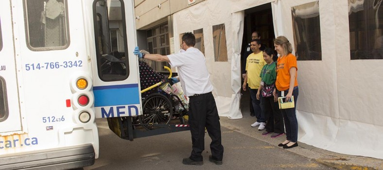 A resident of the Henri Bradet Residential Centre arrives by adapted transport at the Jewish General Hospital.