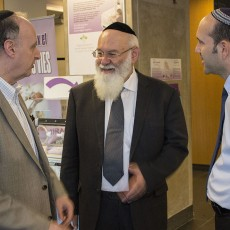 Rabbi Dr. Avraham Steinberg (centre) is welcomed to the Jewish General Hospital by Dr. Lawrence Rosenberg (left), President and CEO of CIUSSS West-Central Montreal, and by Dr. Michael Bouhadana, who organized Rabbi Steinberg's lecture.
