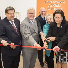 Cutting the red ribbon to inaugurate the Azriel Heart Centre are (from left) Lawrence Rosenberg, President and CEO of CIUSSS West-Central Montreal; Montreal Mayor Denis Coderre; Gaétan Barrette, Minister of Health and Social Services; Edward Wiltzer, Chair of the JGH Foundation; Stephanie Azrieli of the Azrieli Foundation; Naomi Azrieli, CEO of the Azrieli Foundation; and Dr. Lawrence Rudski, JGH Chief of Cardiology and Director of the Azrieli Heart Centre.