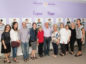 At the Wall of Hope, the donation by Josh Samuels (centre) is acknowledged by (from left) Lilla Sternthal, a friend of the Samuels family; Roz Rinzler, Chair of the Tiny Miracle Fund; Josh's parents, Russell Samuels and Cindy Samuels; Dr. Apostolos Papageorgiou, JGH Chief of Pediatrics and Neonatalogy; Auxiliary Co-Presidents Sarah Hutman and Renna Bassal; Auxiliary Past President Beatrice Lewis; Auxiliary Director Nancy Rubin; and NICU nurse Claudia Cinquino.