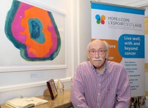 "Mel Boyaner with his work, ""Expanding Form"" (1966), at the Hope & Cope Cancer Wellness Centre."