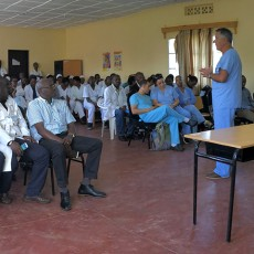In the meeting room of Ruhengeri Hospital in Rwanda, Dr. Jacques Corcos, a JGH Urologist, delivers a lecture to staff about the medical condition that he and other volunteers have been treating during their twice-yearly visits.