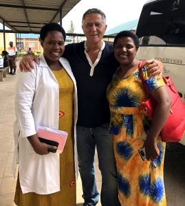 Dr. Jacques Corcos in Ruhengeri, Rwanda, with Marie-Louise (left), a local midwife, and Christine, a social worker.