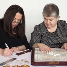 Eleanor Diamond(left), Team Leader of the Braille Production Service at MAB-Mackay Rehabilitation Centre, and Christine Théorêt, an MAB-Mackay client, play braille Scrabble during the White Cane Week event at the JGH.