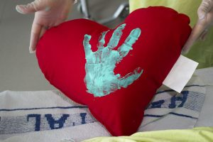 In the JGH Medical-Surgical Intensive Care Unit, the family members of a patient who has died while hospitalized can request a heart-shaped pillow bearing the handprint of the deceased patient.