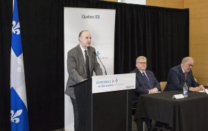 Dr. Lawrence Rosenberg speaks at the news conference, in the company of Dr. Gaétan Barrette (centre) and Pierre Arcand.