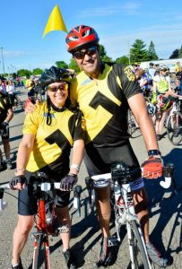 Cheerful cyclists are dressed in commemorative shirts marking the 10th anniversary of the Enbridge Ride to Conquer Cancer.