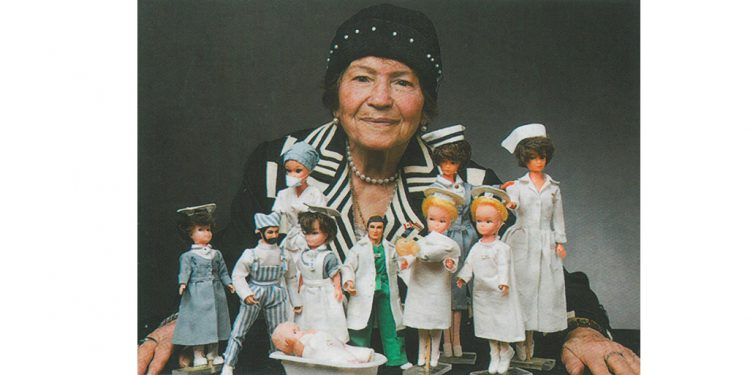 Ossana Zeitounian, seamstress extraordinaire, in 2009 with a few of the dozens of dolls for which she sewed healthcare related uniforms.