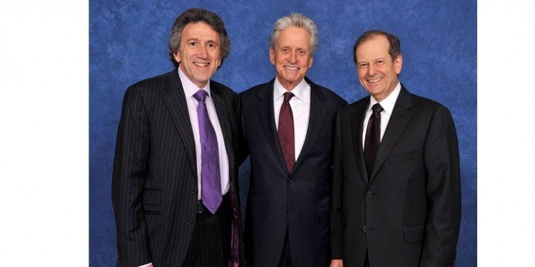 Michael Douglas (centre) with Dr. Saul Frenkiel (right) and Dr. Sheldon Elman, Chairman of Medisys Health Group, at a McGill University fundraising gala co-chaired by Drs. Frenkiel and Elman.