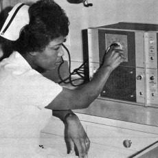 In 1967, Nurse Vashti McClean turns the selector switch of the JGH's new fetal heart monitoring system, as she listen's to an unborn baby's heartbeat through an amplifier (lower left) and watches it on an oscilloscope (upper right).