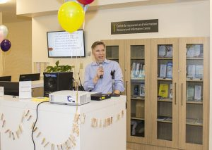 Dr. Karl Looper welcomes visitors to the launch of the Resource and Information Centre.