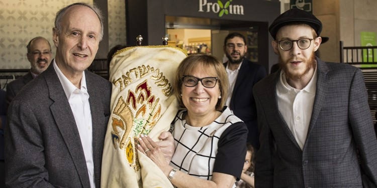 A Torah scroll is dedicated to the chapel of the JGH by Dr. Lawrence Rosenberg, his wife Donna and their son Moshe.