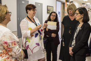 On the eighth floor of Pavilion K, Danielle McCann (right) hears about infection prevention from Lucie Tremblay (second from left), accompanied by (from left) Mona Abou Sader, XX and Dr. Louise Miner.