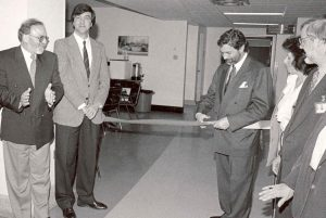 In 1995, Steven Cummings, President of the JGH Board of Directors cuts a ribbon to open newly expanded and renovated psychiatric facilities. He is joined by (from left) Dr. Khalil Geagea, psychiatrist; Executive Director Henri Elbaz; an unidentified member of staff; and Dr. Philip Beck, Chief of the Department of Psychiatry.