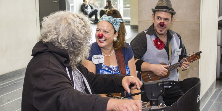 In the lobby of the JGH, a patient is entertained by Jeanette and Frankie, members of Dr. Clown, who are marking 15 years of the organization's connection to the hospital.