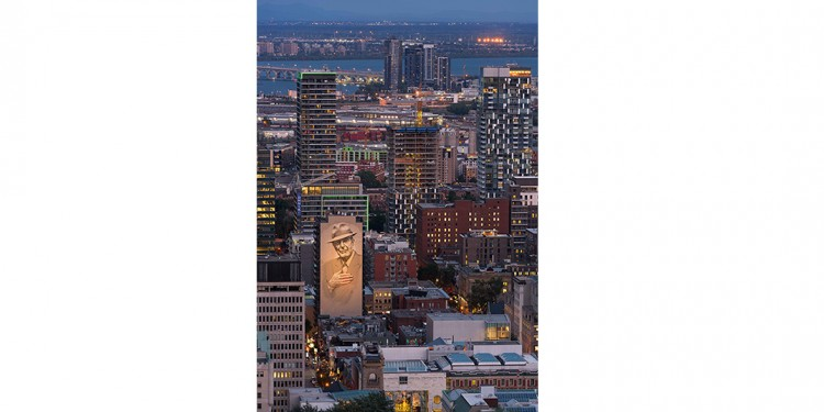 "In her winning photo in the ""A Shot of Happiness"" competition, Vidette Uon, a nurse at Info-Santé, captured the twinkling Montreal skyline at sunset this past August. Its focal point is the enormous, illuminated Tower of Song mural, which covers the side of one building as a tribute to the late singer-composer, Leonard Cohen."