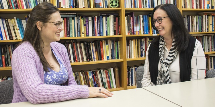 Sarah (left) chats with Dr. Barbara Hayton about the birth of her son last summer.