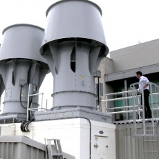 Avi Fhima, a JGH Project Manager in Technical Services, inspects a heat recovery system on the roof of the Lady Davis Institute. This system enables the hospital to recover a substantial portion of the heat and water vapour that would otherwise escape into the air. They are reused to increase energy efficiency and reduce expenses.
