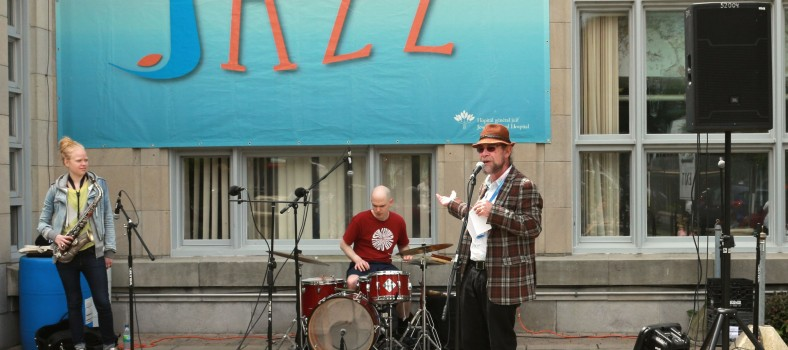 At the JGH Jazz Festival, organizer Bryan Highbloom introduces saxophonist Mette Rasmussen and drummer Chris Corano.