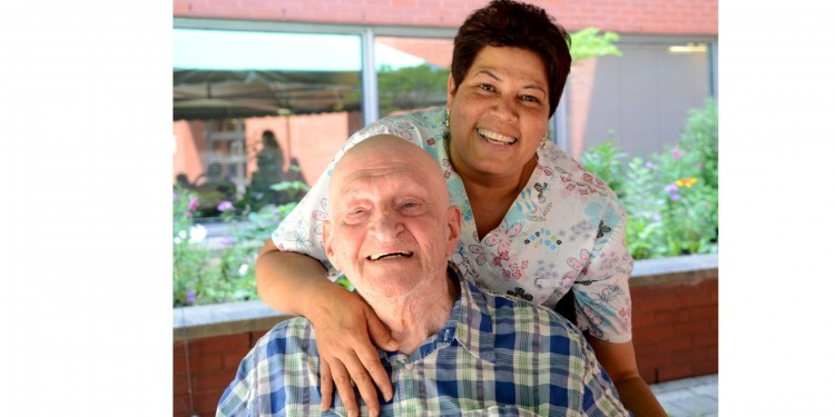 A resident and member of staff at the Jewish Eldercare Centre, which is among the JGH's partner institutions in West-Central Montreal Health.