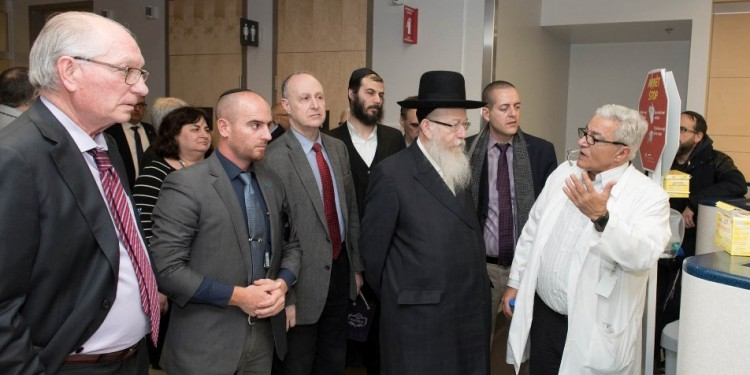 Dr. Marc Afilalo (right), JGH Chief of Emergency Services, discusses health care with Rabbi Yaakov Litzman, accompanied by Dr. Lawrence Rosenberg (centre, in red tie) and Alan Maislin (left).