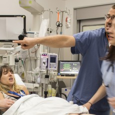During a simulation in the JGH Emergency Department, an expectant mother—played by Emily Churchill-Smith (second from left)—experiences severe pain during labour. She is accompanied by her spouse—played by Andrea Willett (left)—while receiving care from Emergency Nurses Victor Uscatescu and Mélika Charbonneau.
