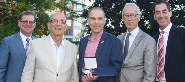 Glenn J. Nashen (centre), with his D'Arcy McGee Medal of Citizenship, is congratulated by (from left) former MNAs Robert Libman and Lawrence Bergman, current MNA David Birnbaum and Cote Saint-Luc Mayor Mitchell Brownstein.