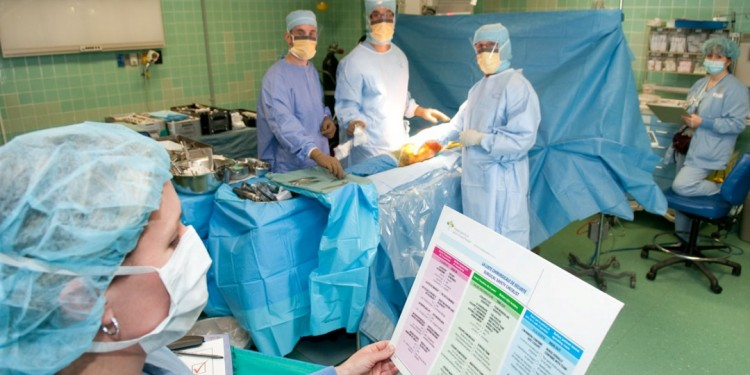 Moments before an operation gets under way in 2010, nurse Anna Pevreal asks Dr. Leonard Rosen (second from right) and members of the surgical team the questions on the JGH Surgical Safety Checklist. Their responses determine that the patient's medical needs have been met and the operation can proceed safely.