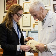 Using a model of a human skull, Dr. Ana Velly discusses her research into dental pain with Dr. Mervyn Gornitsky, who is Director of Research in the JGH Department of Dentistry, as well as the department's Emeritus Chief and a Professor Emeritus at McGill University.
