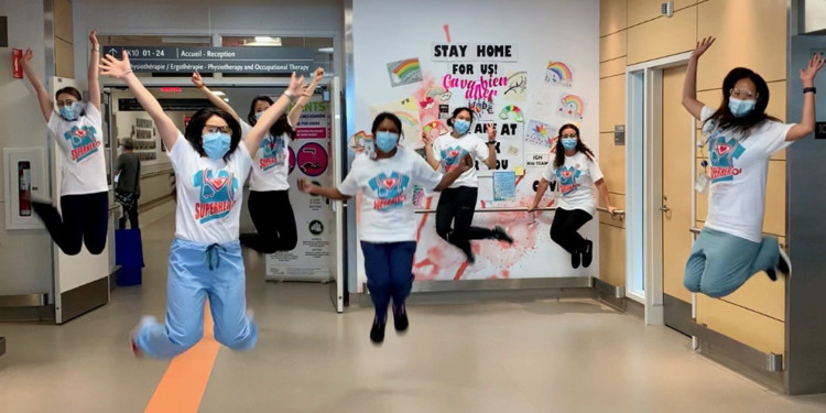 "In a photo that she submitted to the CIUSSS's ""A Shot of Happiness"" competition for staff, Alyssa Pambuan, a JGH Nurse and Stroke Team Coordinator, captured her team's camaraderie during the COVID-19 pandemic. (Click on photo to see a larger version.)"