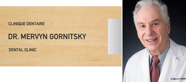 Dr Mervyn Gornitsky et la plaque en son honneur à la Clinique dentaire de l'HGJ.