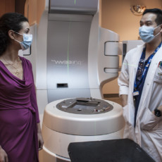 Dr. Magali Lecavalier-Barsoum consults with Technologist Dennis Ip about the linear accelerator that provides radiation therapy to cancer patients in the Division of Radiation Oncology. (Click on photo to enlarge.)