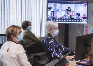 In the Vaccination Command Centre, (from left) Lucie Tremblay, Sonia Boccardi and Joanne Côté examine the latest on screen vaccination data during a video conference with colleagues at various CIUSSS locations.